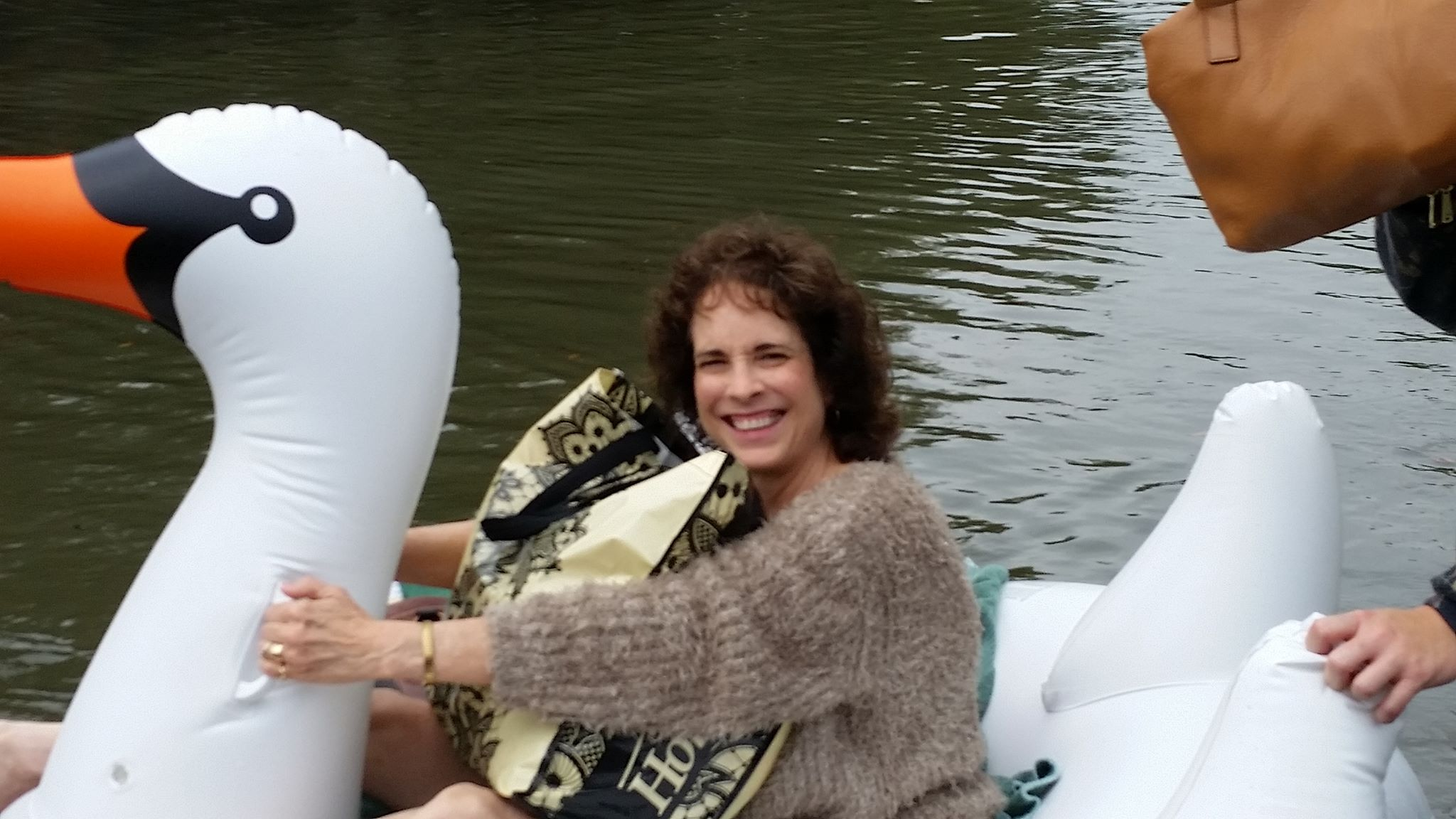 Midwife Rides Inflatable Swan Through Floodwaters to Deliver Baby