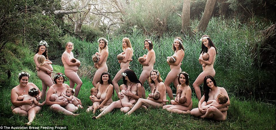 This photographer is capturing group photos of moms nursing their babies.