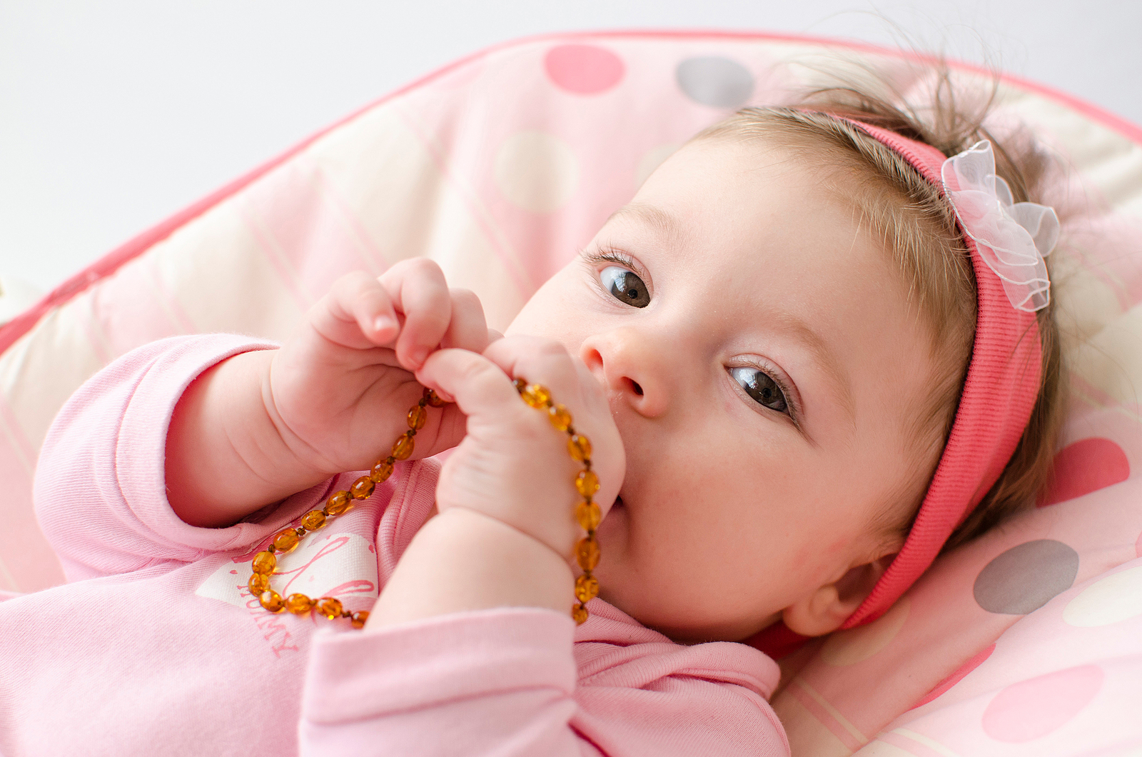 A new study concluded that amber necklaces could pose a strangulation risk to children.