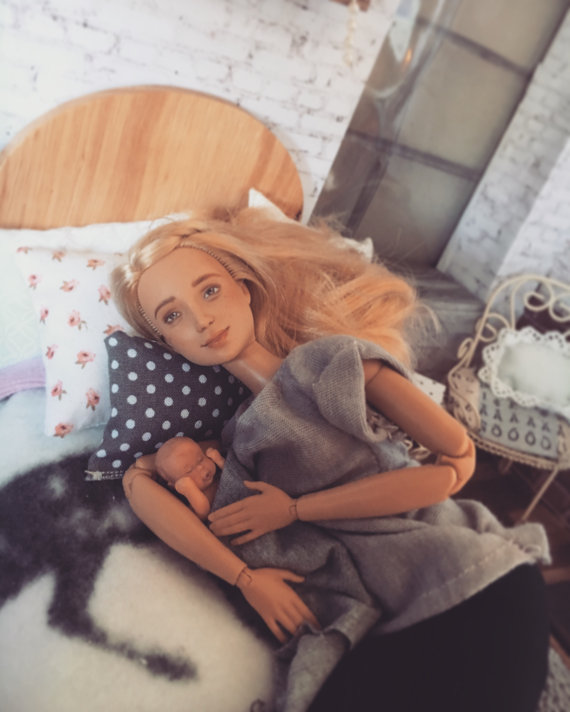 One creative woman has turned the iconic doll into a breastfeeding advocate - maybe she can be a role model for girls.