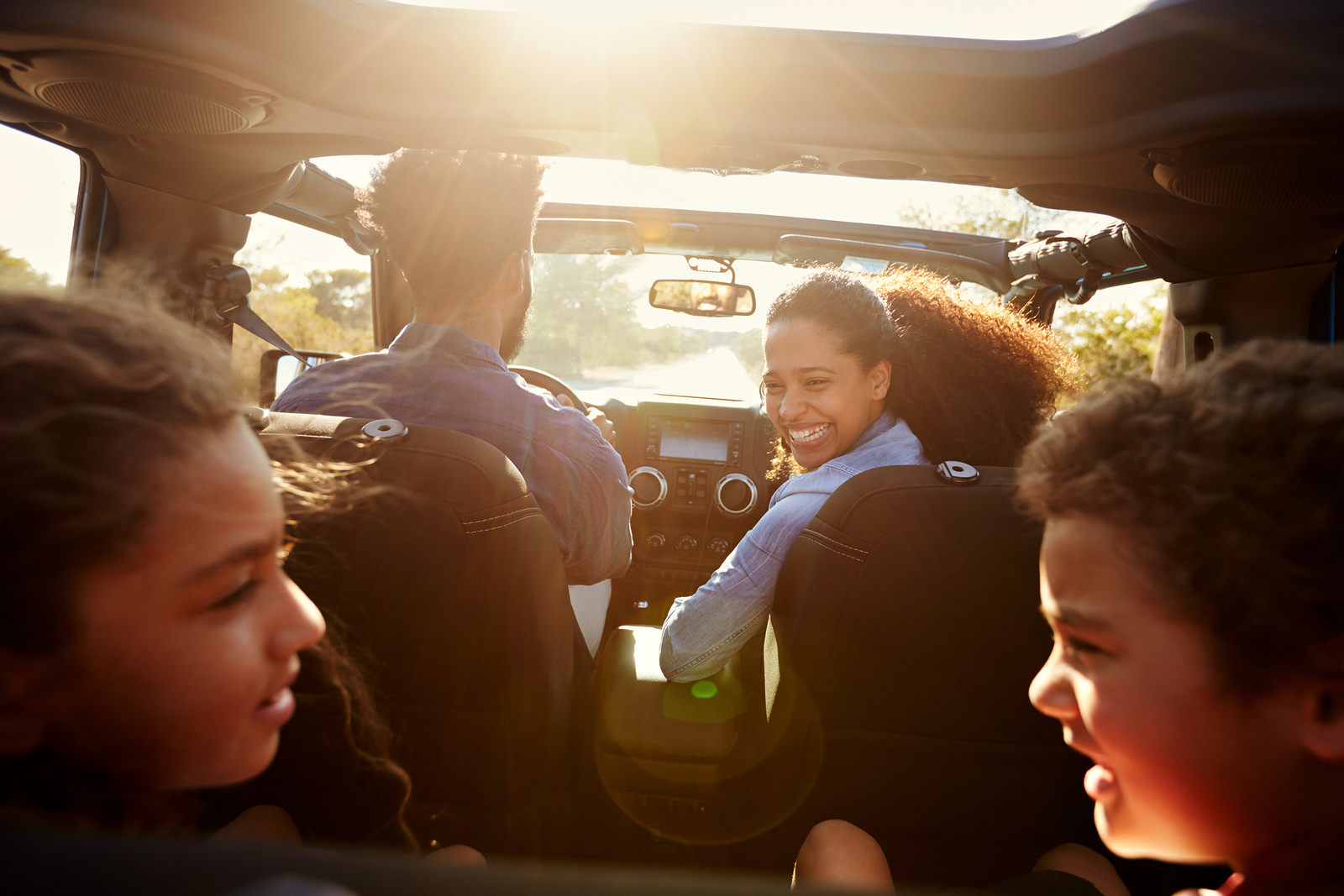 Here are some podcasts to make long family drives bearable.