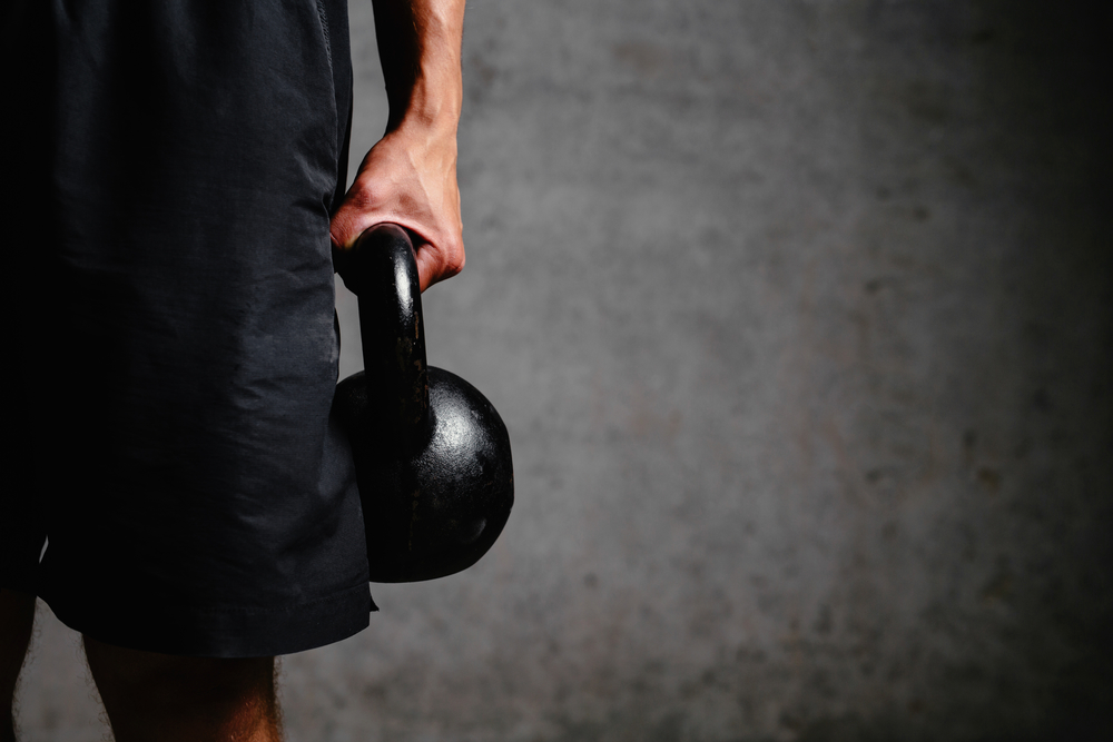 This man strapped a 14-pound ball to his stomach and hit the gym.