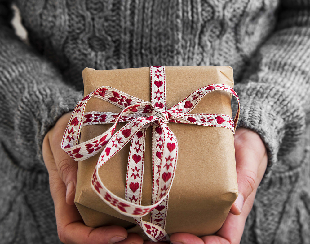 This year, I will reduce my footprint by using alternatives to gift wrap.