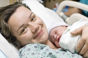 Happy mother with newborn baby