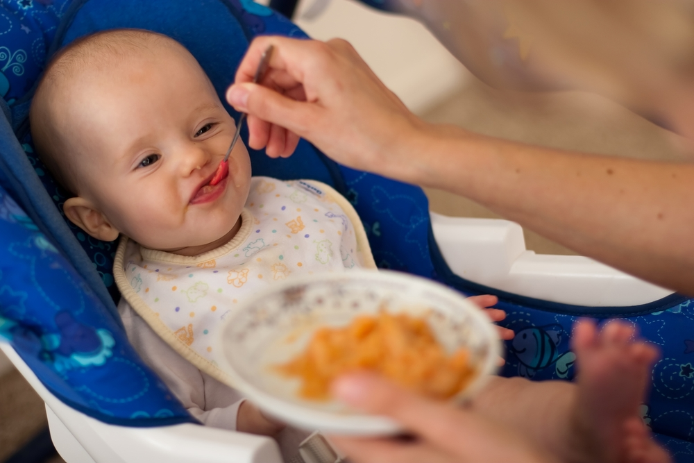 Feeding babies solid food from as early as three months of age may help them to sleep better.