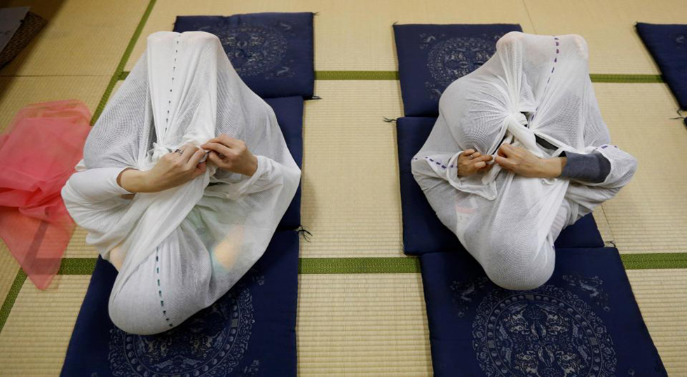 Japanese Moms Are Wrapping Up Postpartum Pains, Literally!