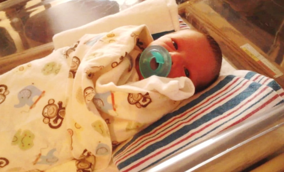 An Oregon Mother sues hospital that let her bedshare with son, who was suffocated.