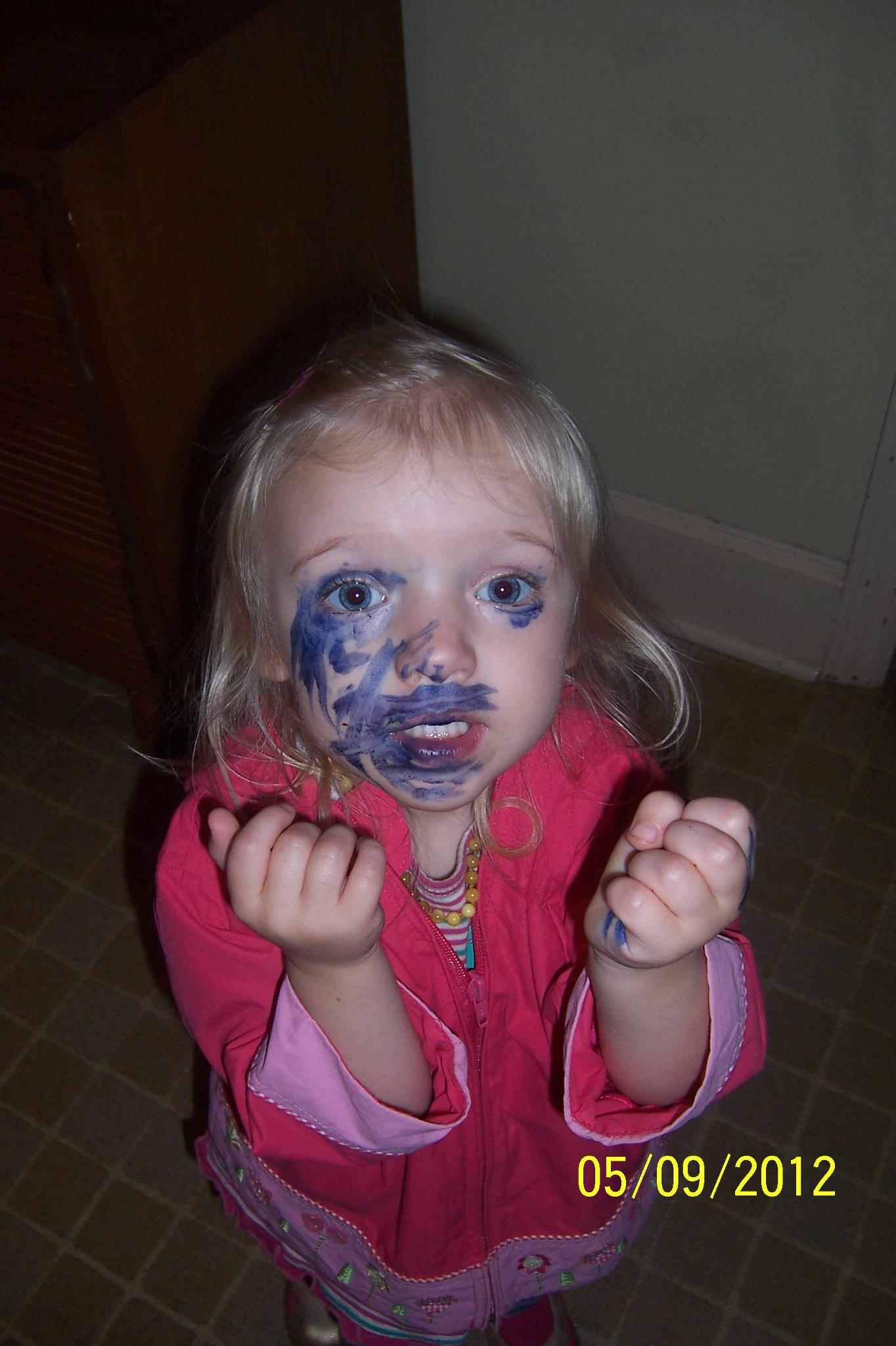 crayola washable marker smeared over face........