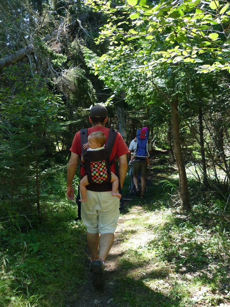 My husband carrying our 12-month-old daughter in the Beco Gemini during a hike near Thunder Bay, ON.