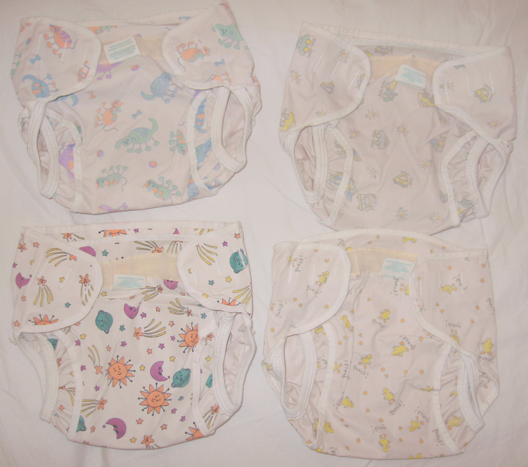 080608 Lot of 4 Cloth Diaper Covers Kooshies Kushies Size Infant 10-22 lb.JPG